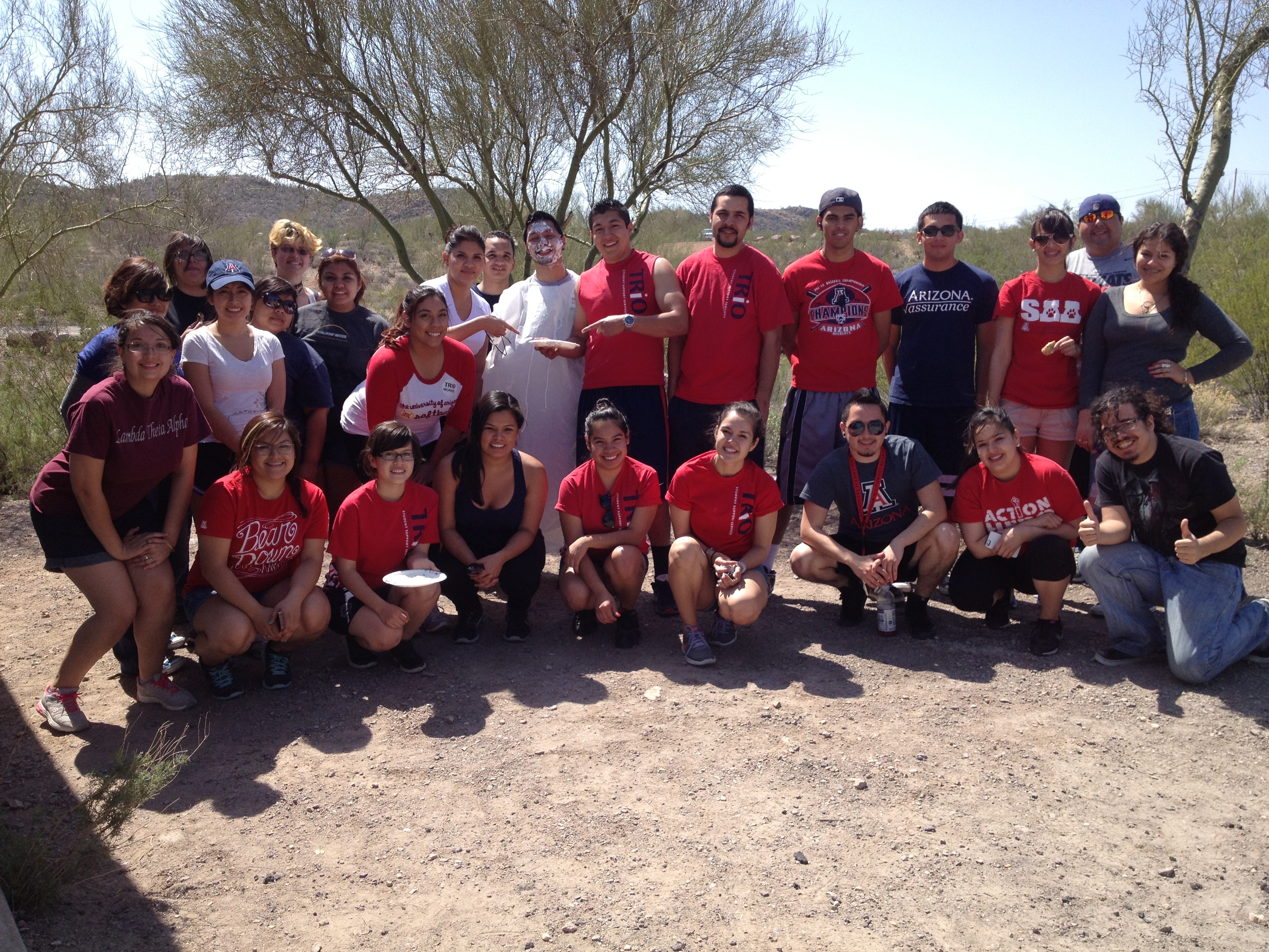 Group picture of trio students after cleaning the park.